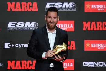 Barcelona's Argentinian forward Lionel Messi poses with his sixth Golden Shoe awards after receiving the 2019 European Golden Shoe honoring the year's leading goalscorer during a ceremony at the Antigua Fabrica Estrella Damm in Barcelona on Thursday. — AFP