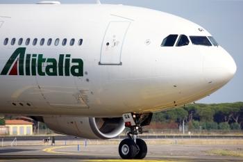 FILE PHOTO: An Alitalia airplane is seen before take off from the Leonardo da Vinci-Fiumicino Airport in Rome, Italy, June 21, 2018. REUTERS/Stefano Rellandini/File Photo