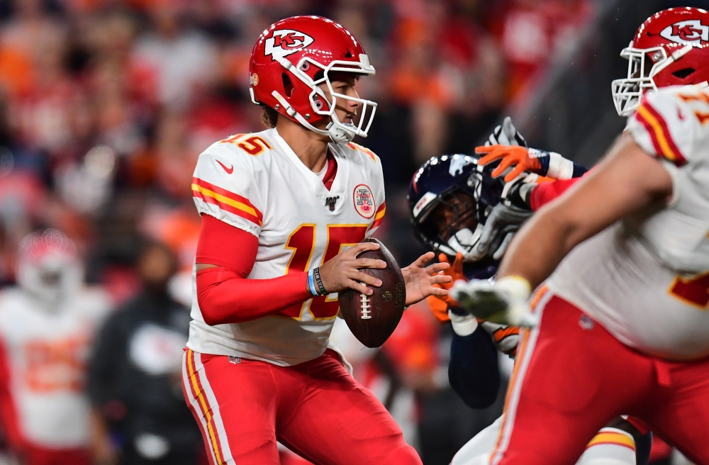 Kansas City Chiefs quarterback Patrick Mahomes (15) drops pack to pass the ball in the first quarter against the Denver Broncos at Empower Field at Mile High. — Reuters