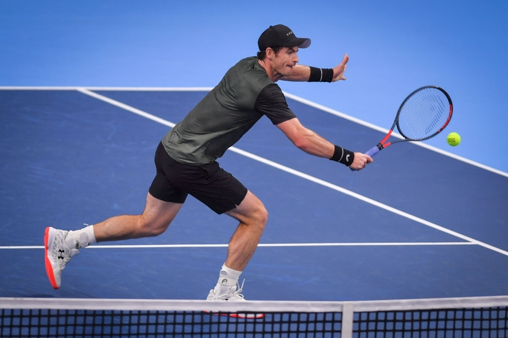 Britain's Andy Murray returns a shot during a tennis match against Uruguay's Pablo Cuevas, in the second round of the men's singles tournament at the European Open ATP Antwerp, on Thursday, in Antwerp.  — AFP