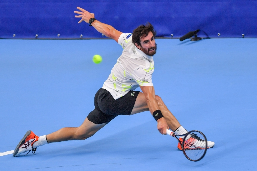 Uruguay's Pablo Cuevas returns a shot during a tennis match against Britain's Andy Murray, in the second round of the men's singles tournament at the European Open ATP Antwerp, on Thursday, in Antwerp.  — AFP