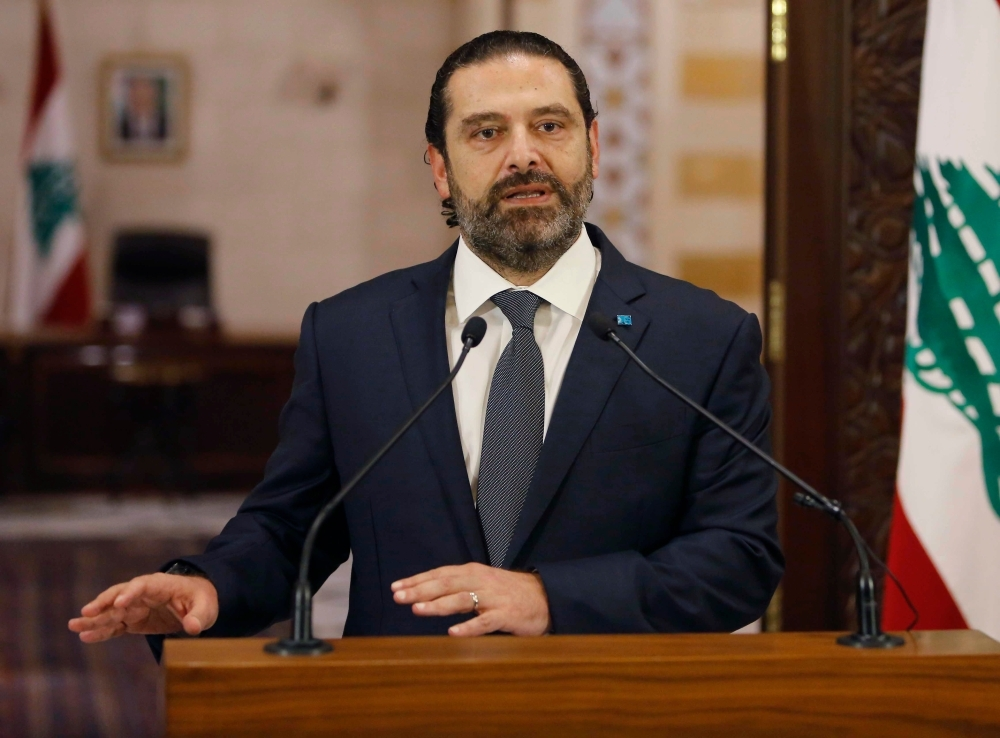 Lebanese Prime Minister Saad Al-Hariri gives an address at the government headquarters in the center of the capital Beirut on Friday. — AFP