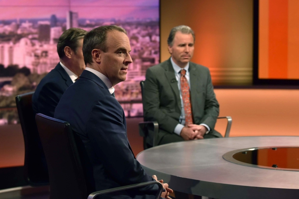 In a handout picture released by the BBC Britain's Foreign Secretary and First Secretary of State Dominic Raab (C), Britain's main opposition Labour Party shadow Secretary of State for Exiting the EU Keir Starmer (L) and former Conservative Party MP, now Independent, Oliver Letwin (R) appear on the BBC political program The Andrew Marr Show in London on Sunday.  Britain will leave the European Union on time on Oct. 31, the government insisted Sunday after MPs voted to force the Prime Minister into seeking yet another delay. Johnson reluctantly sent European Council President a letter legally imposed on him by parliament requesting an extension — but refused to sign it. — AFP