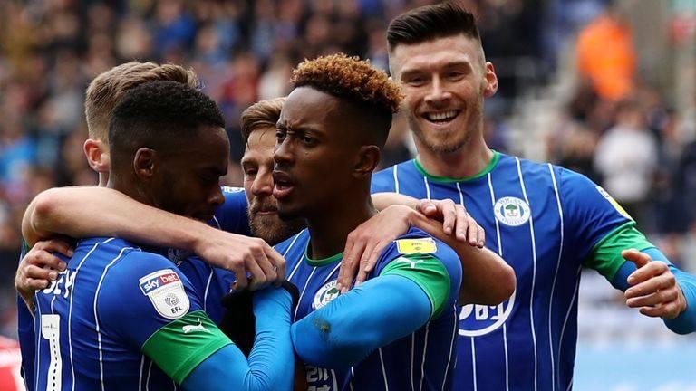 Jamal Lowe celebrates after scoring the winner for Wigan.