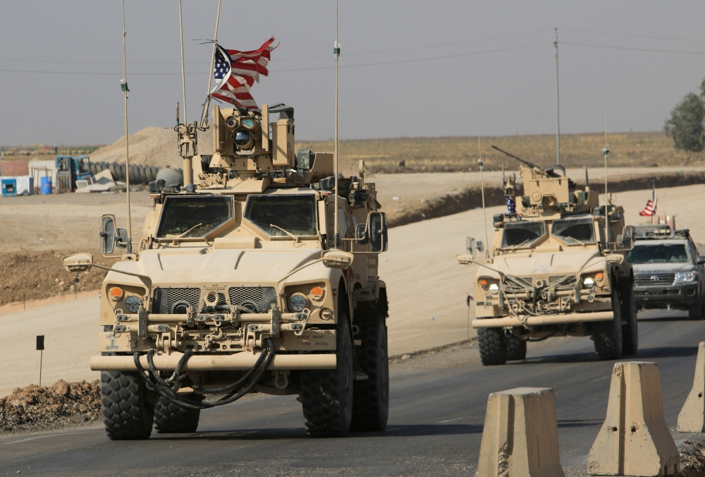 A convoy of US vehicles is seen after withdrawing from northern Syria, at the Iraqi-Syrian border crossing in the outskirts of Dohuk,, Iraq, on Monday. — Reuters