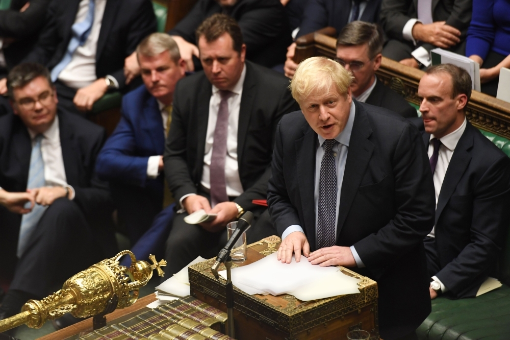 A handout picture released by the UK Parliament shows Britain's Prime Minister Boris Johnson, right, speaking in the House of Commons in London on Oct. 19, 2019, during a debate on the Brexit deal. — AFP