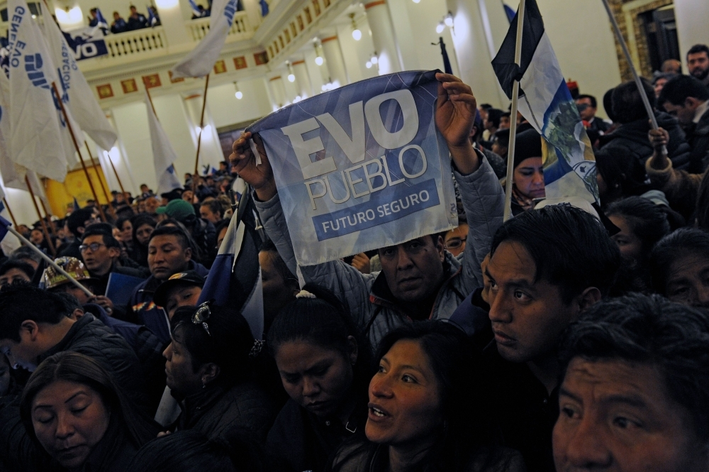 Supporters of Bolivian President and presidential candidate for the Movimiento al Socialismo (MAS) Evo Morales celebrate after knowing the partial results of the general elections at Quemado presidential palace in La Paz on Sunday. — AFP