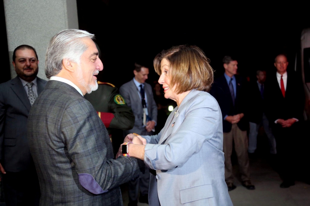 US House Speaker Nancy Pelosi shakes hand with Afghanistan Chief Executive Abdullah Abdullah in Kabul, Afghanistan, on Sunday. — Reuters