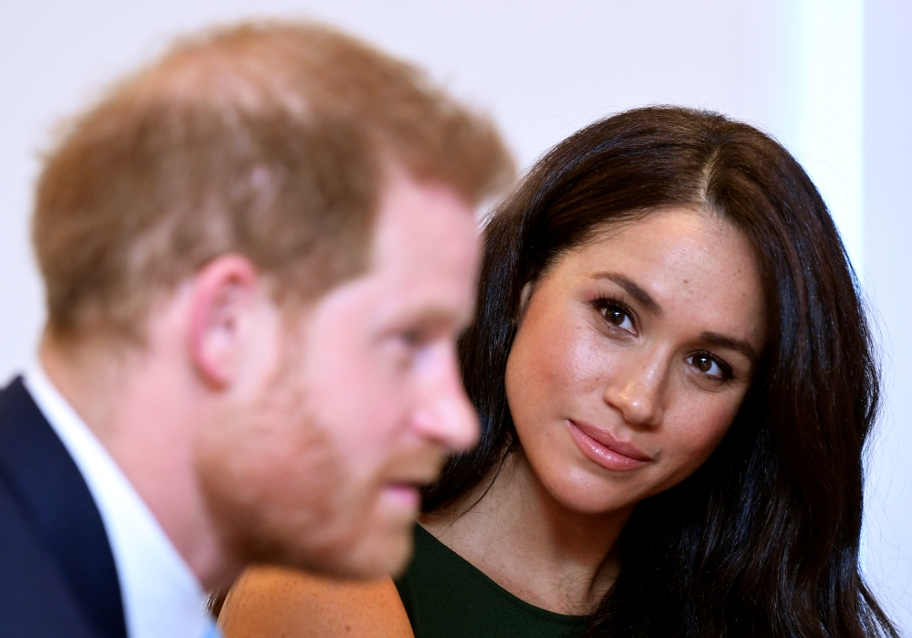 Meghan, Duchess of Sussex, looks at Britain's Prince Harry during the WellChild Awards pre-ceremony reception in London, Britain, in this Oct. 15, 2019 file photo. — Reuters