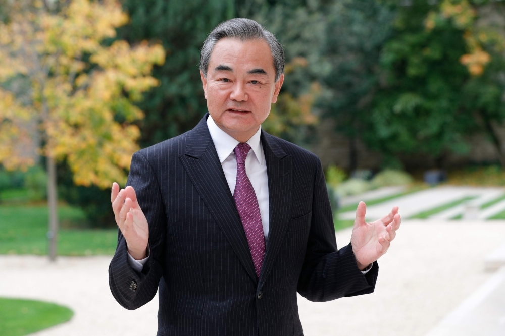 Chinese Foreign Minister Wang Yi poses after an interview in Paris on Monday. — AFP