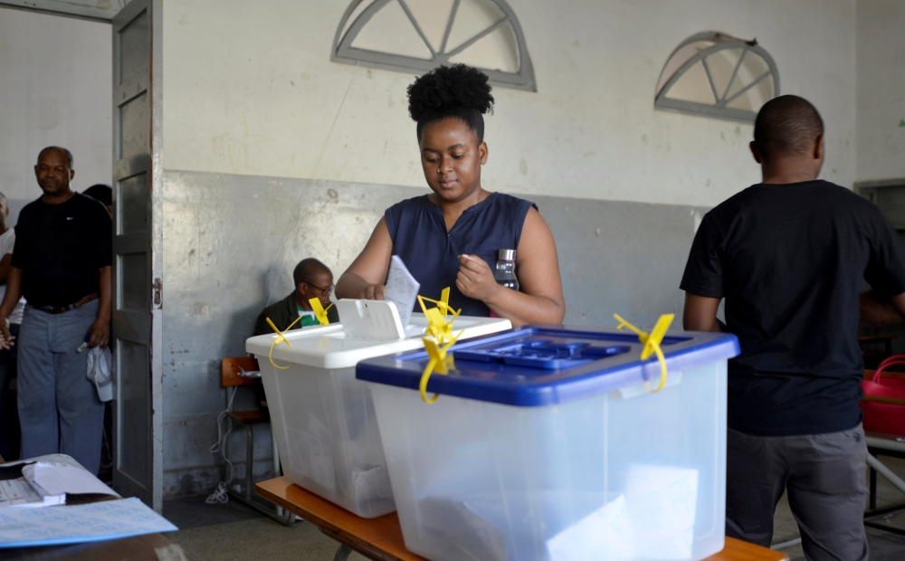 A woman casts her vote during presidential, legislative and provincial elections in Maputo, Mozambique, in this Oct. 15, 2019 file photo. — Reuters