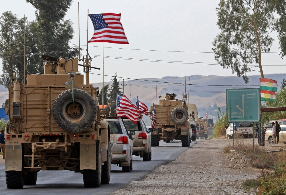 A convoy of US military vehicles arrives near the Iraqi Kurdish town of Bardarash in the  Dohuk governorate after withdrawing from northern Syria on Monday. — AFP