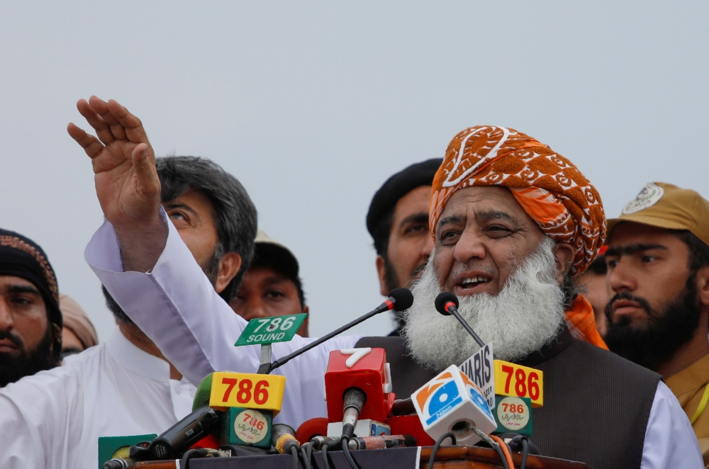 Fazl-ur-Rehman, president of the Jamiat Ulema-e-Islam (JUI), speaks to the supporters during a countrywide protest called