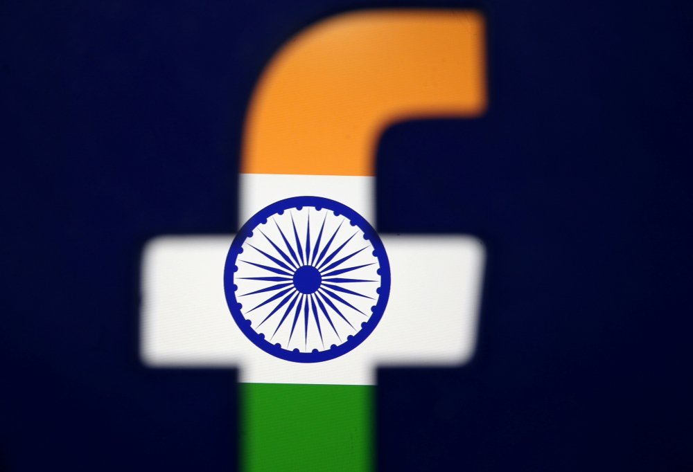 India's flag is seen through a 3D printed Facebook logo in this illustration picture on April 8, 2019. — Reuters