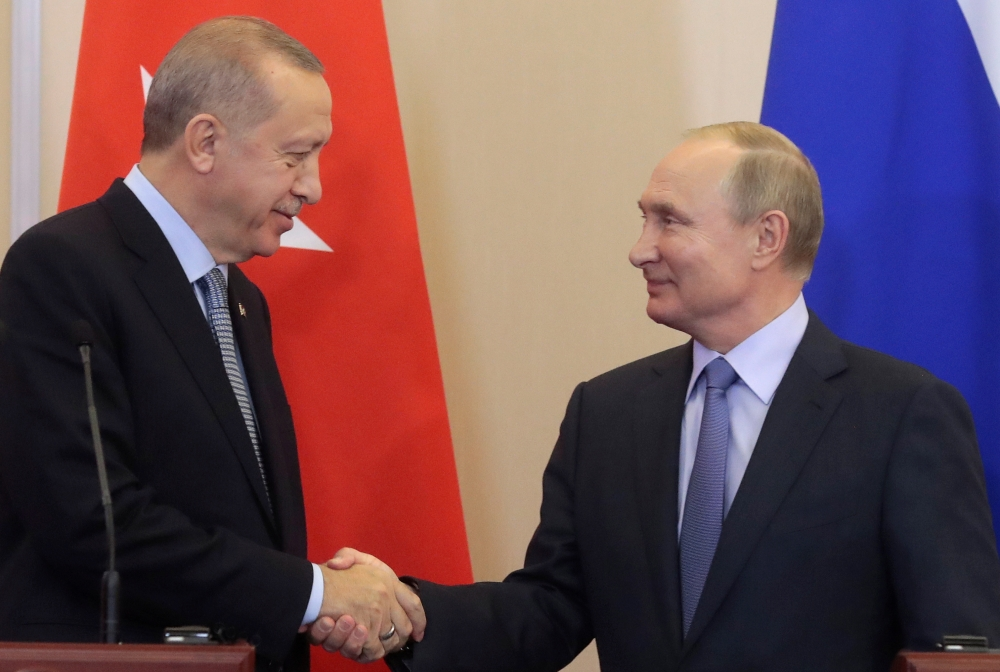 Russian President Vladimir Putin, right, shakes hands with Turkish President Recep Tayyip Erdogan, left,  during their joint news conference following Russian-Turkish talks in the Black sea resort of Sochi, Russia, on Tuesday. — Reuters