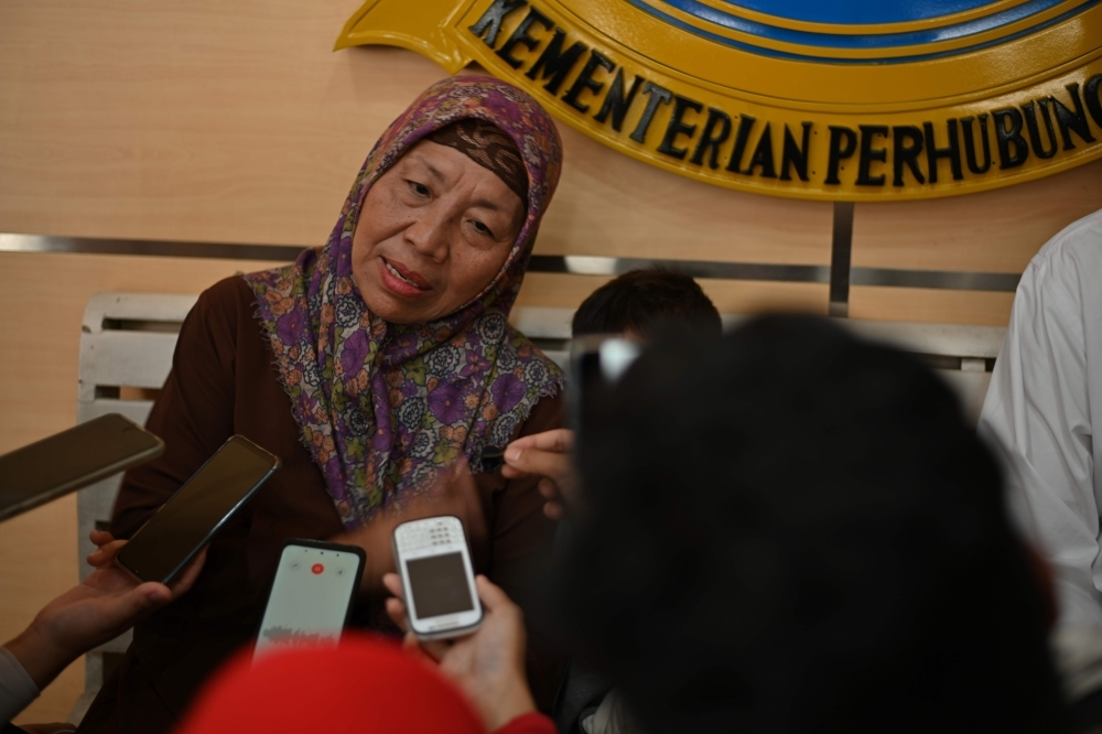 Nurjannah, the mother of air attendant instructor Denny Maulana who was killed when Lion Air flight 610 on Oct. 29, 2018 crashed into the sea shortly after takeoff, speaks to journalists before a meeting between families of victims and Indonesia's National Transportation Safety Committee in Jakarta on Wednesday. — AFP
