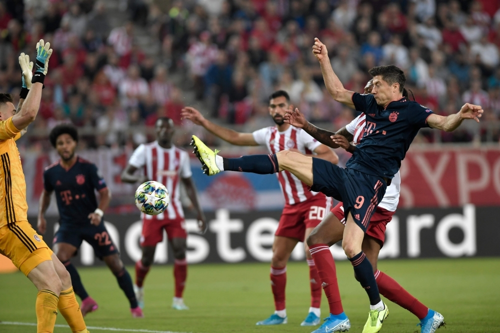 Bayern Munich's Polish forward Robert Lewandowski scores a goal during the UEFA Champions League group B football match between Olympiacos FC and FC Bayern Munchen at the Georgios Karaiskakis stadium in Piraeus near Athens, on Tuesday. — AFP