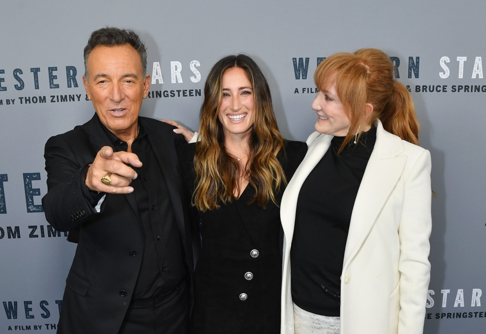 US singer-songwriter Bruce Springsteen, left, his daughter Jessica Springsteen, center, and his wife Patti Scialfa attend the New York special screening of