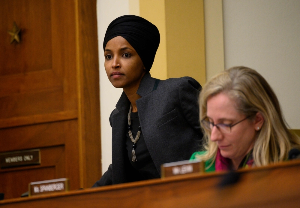 US Representative, Ilhan Omar, arrives as representative Abigail Spanberger, looks at her notes during an Asia, the Pacific and Nonproliferation Subcommittee hearing on