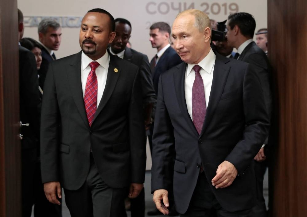 Russian President Vladimir Putin and Ethiopian Prime Minister Abiy Ahmed meet on the sidelines of the Russia-Africa Summit and Economic Forum in Sochi, Russia October 23, 2019. Sergei Chirikov/Pool via REUTERS