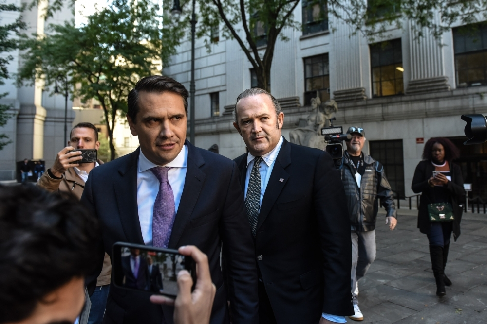 Igor Fruman (C) exits federal court for an arraignment hearing on October 23, 2019 in New York City. Lev Parnas and Igor Fruman, along with Andrey Kukushkin and David Correia, are associates of Rudy Giuliani who have been arrested for allegedly conspiring to circumvent federal campaign finance laws in schemes to funnel foreign money to US candidates running for office at the federal and state levels. — AFP
