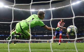 Atletico Madrid's Alvaro Morata scores their first goal against Bayer Leverkusen at Wanda Metropolitano, Madrid, Spain, on Tuesday. — Reuters