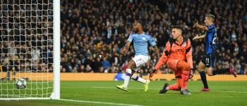 Manchester City's English midfielder Raheem Sterling (L) scores their fifth goal to complete his hattrick during the UEFA Champions League Group C football match between Manchester City and Atalanta at the Etihad Stadium in Manchester, northwest England, on Tuesday. — AFP