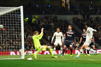 Tottenham Hotspur's South Korean striker Son Heung-Min (R) scores his team's second goal during the UEFA Champions League Group B football match between Tottenham Hotspur and Red Star Belgrade at the Tottenham Hotspur Stadium in north London, on Tuesday. — AFP