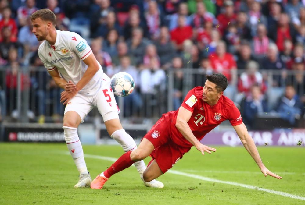 Bayern Munich's Robert Lewandowski in action with 1. FC Union Berlin's Marvin Friedrich at Allianz Arena, Munich, Germany, on Saturday. — Reuters