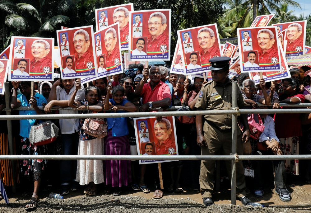 Supporters of Sri Lanka People's Front party presidential election candidate and former wartime defence chief Gotabaya Rajapaksa hold his images during an election campaign rally in Bandaragama, Sri Lanka November 3, 2019. -Reuters