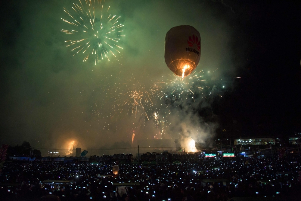 This picture taken on November 4, 2019 shows a hot-air balloon in the sky during the Tazaungdaing Lighting Festival at Taunggyi in Myanmar's northeastern Shan State. -AFP