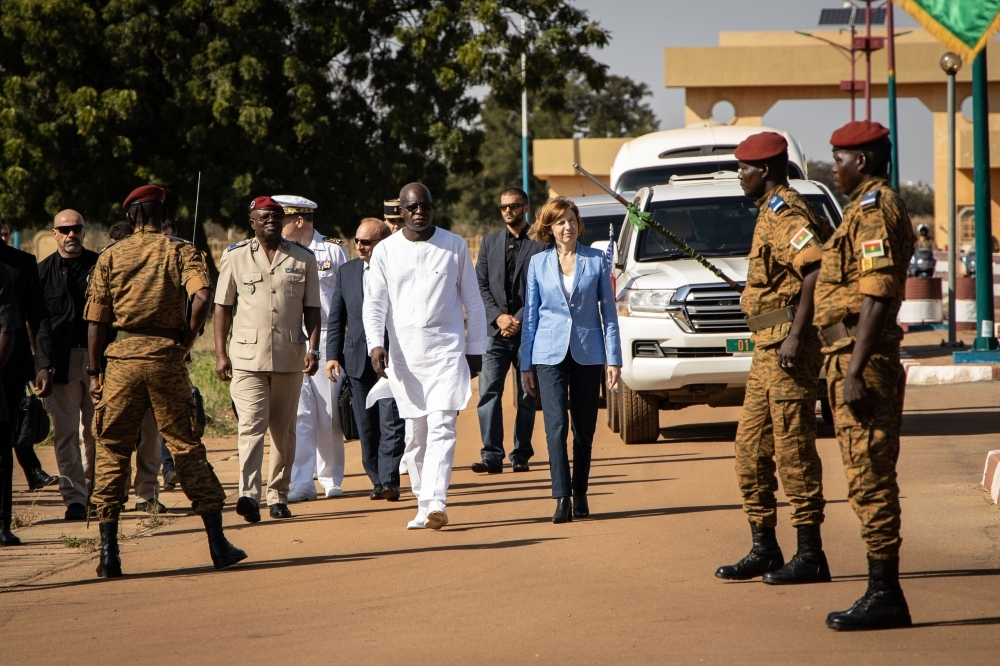 Cherif Sy, Burkina Faso's Defense Minister, center left, and Florence Parly, France's Defense Minister, center right, review the troops during a visit at the Ministry of Defense in Ouagadougou, in this Nov. 4, 2019 file photo. — aFP