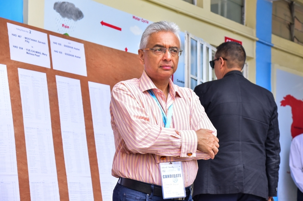 Mauritius's Prime Minister Pravind Jugnauth of Militant Socialist Movement (MSM) party observes a polling station for the Parliamentary election at Soopaya Soobiah Government School in Reduit, Mauritus, on November 7, 2019. -AFP