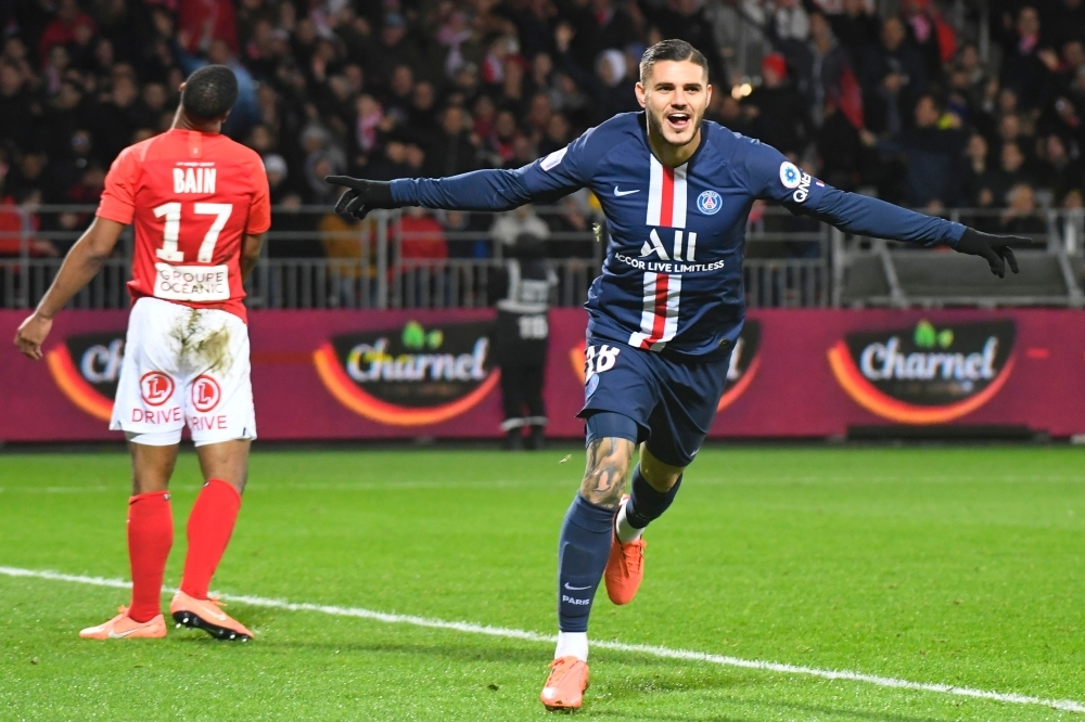 Paris Saint-Germain's Argentine forward Mauro Icardi (R) celebrates after scoring a goal during the French L1 football match between Stade Brestois 29 and Paris Saint-Germain in Brest, western France on Saturday. — AFP
