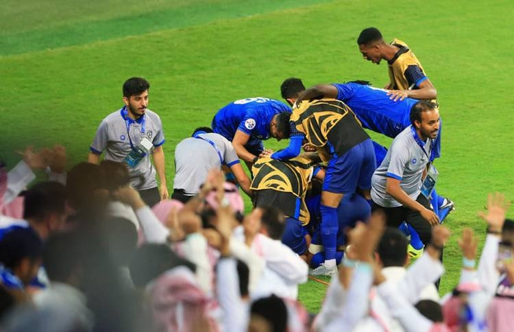Al-Hilal's Andre Carrillo is mobbed by teammates after scoring the winning goal with a header in the second half against Urawa Red Diamonds in the first leg of the AFC Champions League final at the King Saud University Stadium in Riyadh on Saturday.