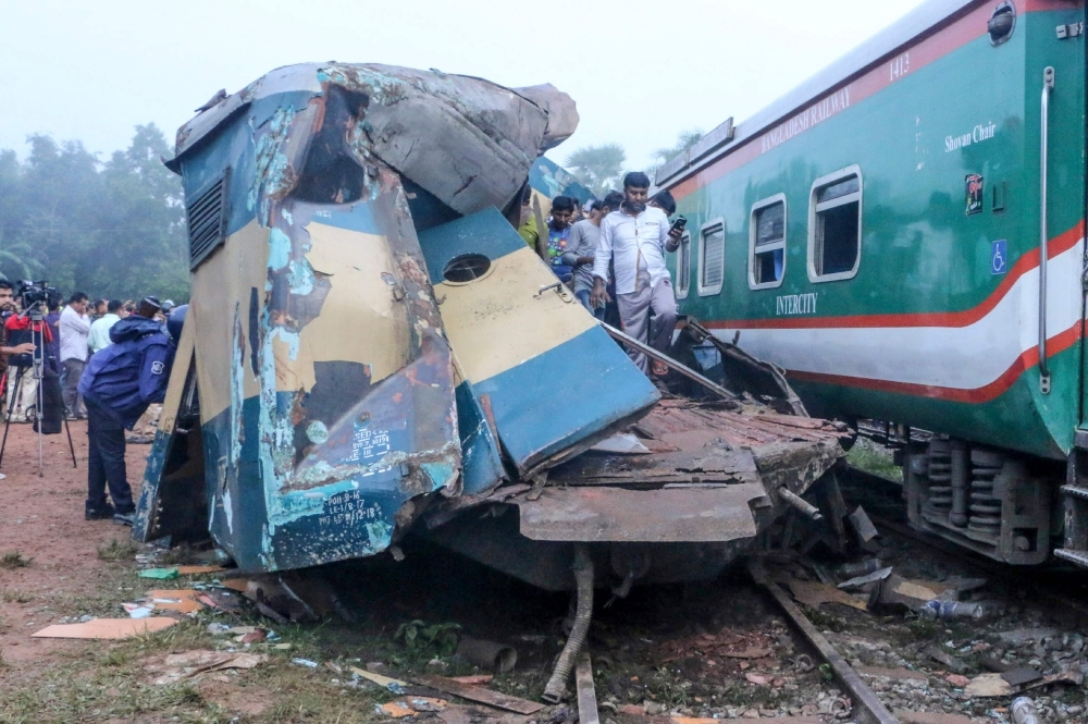 Bystanders look on after a train collided with another train in Brahmanbaria some 130 km from Dhaka on Tuesday. — AFP