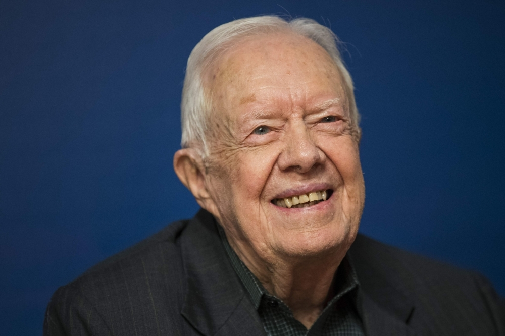Former US President Jimmy Carter smiles during a book signing event for his new book 'Faith: A Journey For All' at Barnes & Noble bookstore in Midtown Manhattan, in New York City in this March 26, 2018 file photo. — AFP