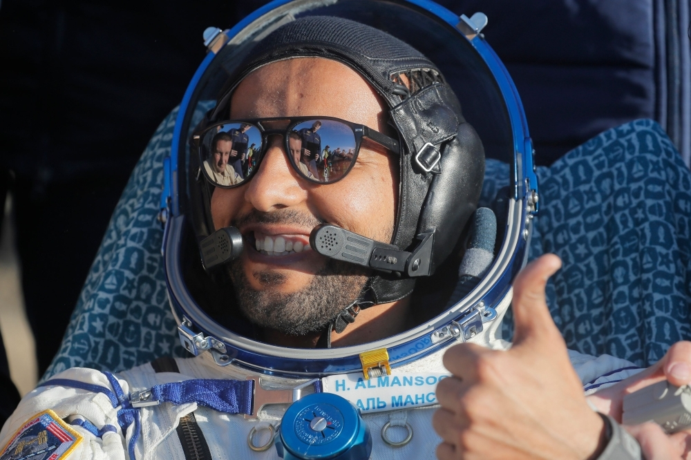 United Arab Emirates astronaut Hazzaa Al-Mansoori gives the thumbs-up shortly after the landing of the Russian Soyuz MS-12 space capsule about 150 km (90 miles) south-east of the Kazakh town of Dzhezkazgan in this Oct. 3, 2019 file photo. — AFP