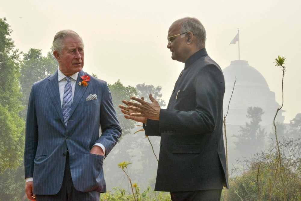 India's President Ram Nath Kovind, right, interacts with Britain's Prince Charles at Herbal Garden 2 in 'Rashtrapati Bhavan' presidential palace in New Delhi on Wednesday. — AFP