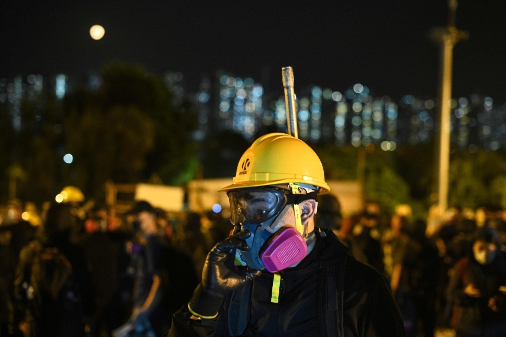 Protesters gather at the Chinese University of Hong Kong (CUHK), in Hong Kong on Wednesday. — AFP