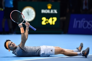 Austria's Dominic Thiem celebrates victory against Serbia's Novak Djokovic during their men's singles round-robin match on day three of the ATP World Tour Finals tennis tournament at the O2 Arena in London on Tuesday. Austria's Dominic Thiem beat Serbia's Novak Djokovic 6-7; 6-3; 7-6. — AFP