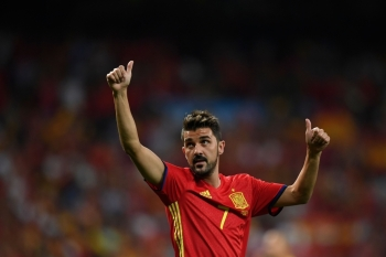 In this file photo taken on Sept. 2, 2017, Spain's forward David Villa waves as he celebrates their victory at the end of the World Cup 2018 qualifier football match Spain vs Italy at the Santiago Bernabeu stadium in Madrid. Star striker Villa, who holds the record for most international goals scored for Spain, announced on Tuesday he was quitting professional football at the end of the season.  — AFP