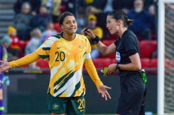 Australia's forward Sam Kerr (L) speaks with the referee during an international friendly football match between Australia and Chile at Coopers Stadium in Adelaide on Tuesday. — AFP