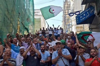 Algerian protesters chant anti-government slogans during a protest near the parliament building in Algiers in this Oct. 13, 2019 file photo. — AFP