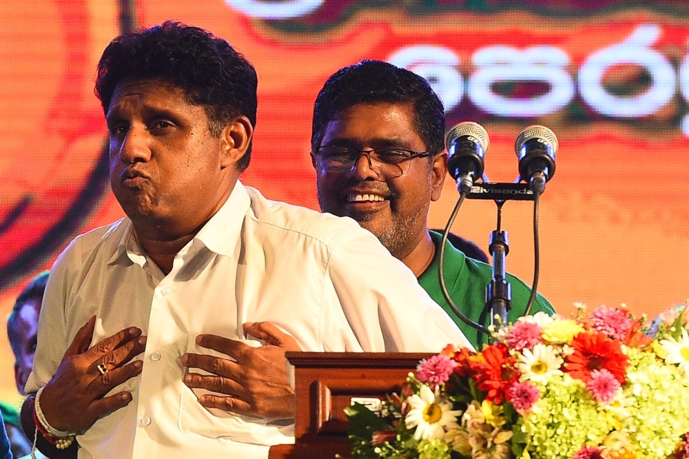Deputy leader of the ruling United National Party (UNP) and New Democratic Front presidential candidate Sajith Premadasa, left, reacts after delivering a speech during the final campaign rally in Colombo on Wednesday ahead of the Nov. 16 presidential election. — AFP