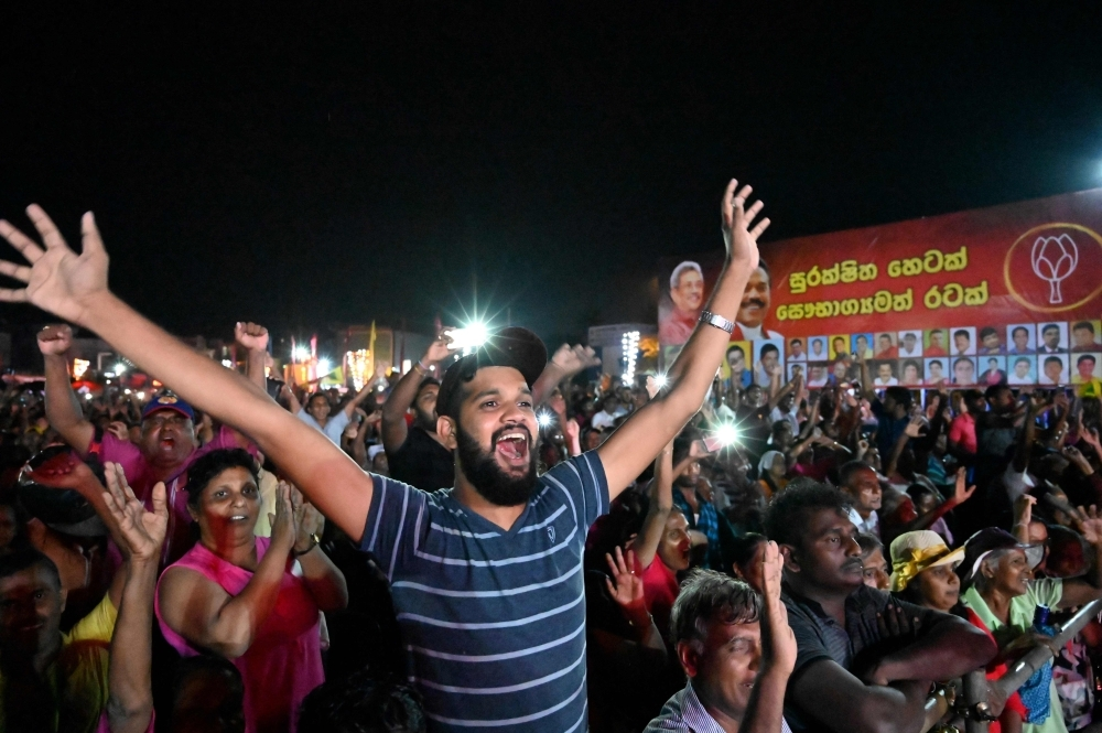 Supporters of Sri Lanka Podujana Peramuna (SLPP) party presidential candidate Gotabhaya Rajapaksa shout slogans during a campaign rally in Homagama on Wednesday. — AFP