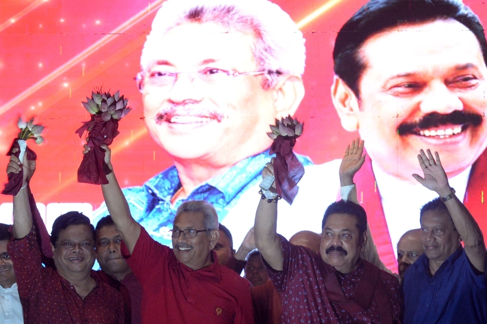 Sri Lanka Podujana Peramuna (SLPP) party presidential candidate Gotabhaya Rajapaksa, second left, and his brother, former Sri Lanka's president Mahinda Rajapaksa, second right, wave at supporters during a campaign rally in Homagama on Wednesday, ahead of the November 16 presidential election. — AFP