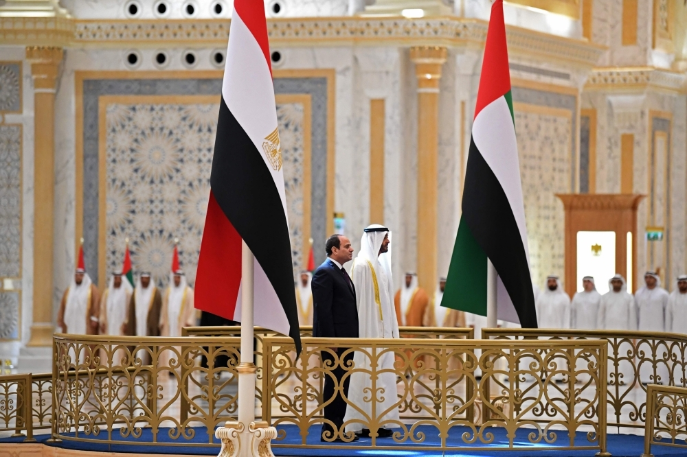 Egyptian President Abdel Fattah El-Sisi and the Crown Prince of Abu Dhabi, Sheikh Mohamed Bin Zayed Al-Nahyan, attend a welcome ceremony in the Emirati capital's Al-Watan presidential palace in Abu Dhabi on Thursday. — AFP