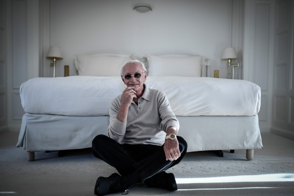 French composer Jacques Revaux poses during a photo session at the Raphael Hotel in Paris on Nov. 12, 2019. — AFP