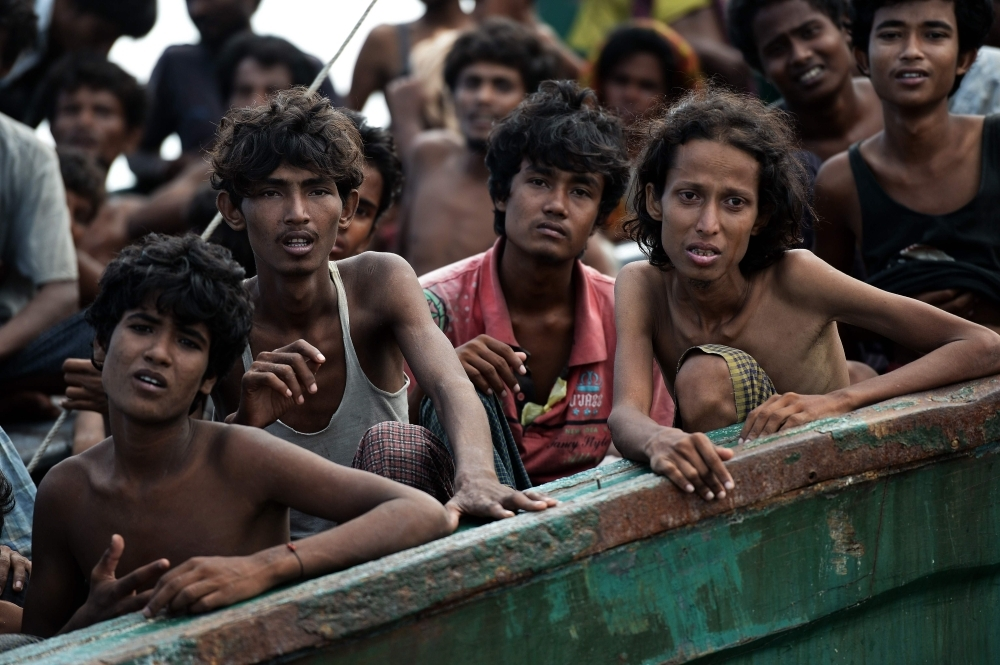 Rohingya migrants sit on a boat drifting in Thai waters off the southern island of Koh Lipe in the Andaman sea in this May 14, 2015 file photo. — AFP